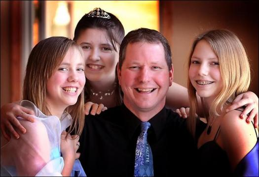 Brad Krause will attend the Purity Ball today with daughters Tanyce (left) and Titiana. Behind them is Emily Volkmer, the girls' cousin, who will attend with her father. (Photo courtesy John Cross/Mankato Free Press)